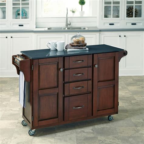cherry kitchen island cart home styles aspen rustic cherry kitchen island with granite top 5520 945 the home depot
