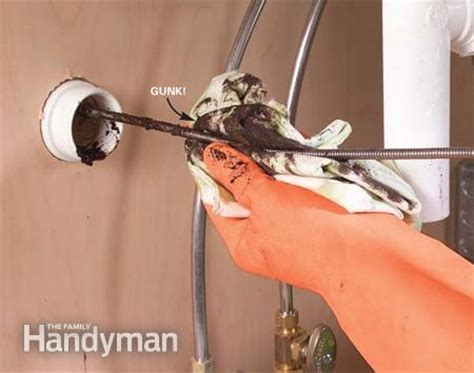 how to clear a kitchen sink blockage how to clear clogged sink drains the family handyman