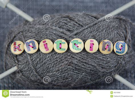 knitting words grey of wool with the word knitting spelled in