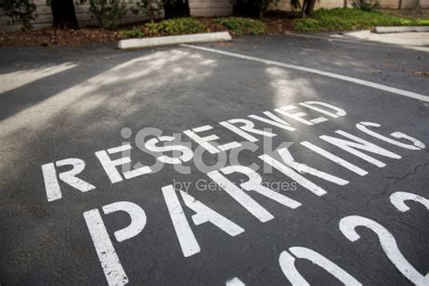 Cool Barn Designs reserved parking spot painted on asphalt stock photos