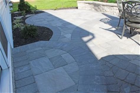 concrete patio vs pavers pavers vs sted concrete patios part 1 tomlinson