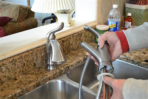 change kitchen sink how to replace a kitchen sink faucet
