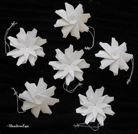 origami snow flakes origami snowflake ornaments by shadowzyn on deviantart