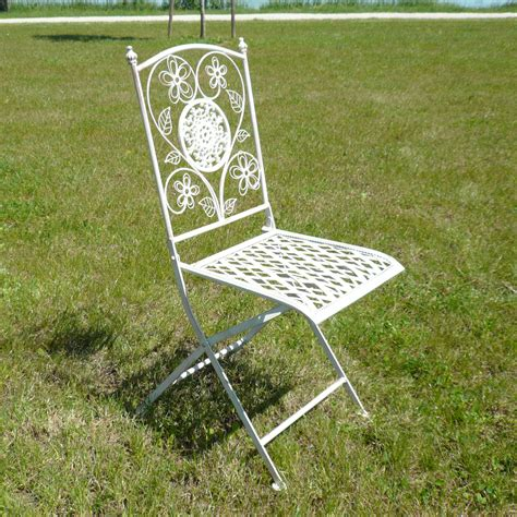 pair of wrought iron chairs tables benches