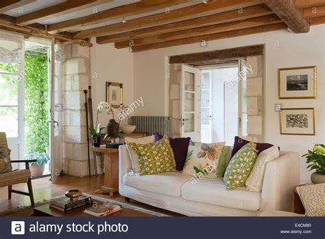 white sofa in living room white sofa in living room with wooden ceiling beams and