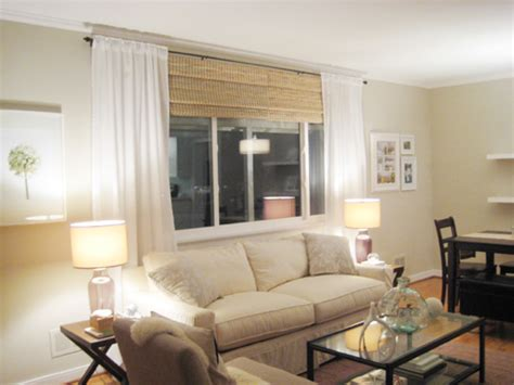 Ikea Livingroom make your picture windows look huge by hanging bamboo