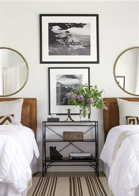 two beds make bedroom with beds black and white photography and