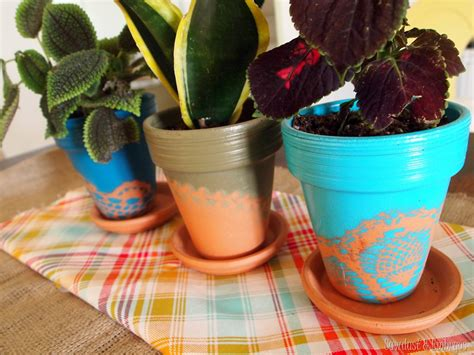 spray painting terracotta pots doily stenciled terra cotta pots