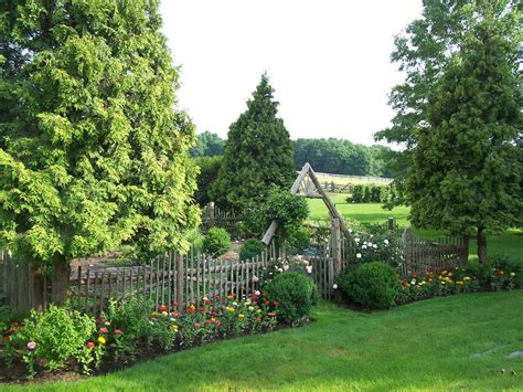 traditional cottage garden flowers wooden fence gates landscape traditional with cottage