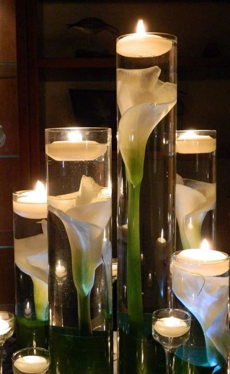 water in vases submerged calla water scent floating candles