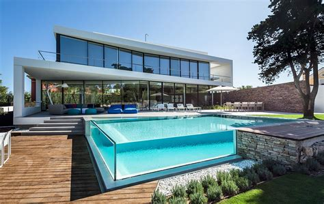 house with swimming pool glass walled swimming pools 10 amazing designs