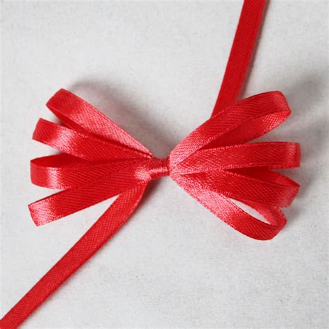 how to make a ribbon bow for a card gift wrapping how to make a fancy bow using a comb