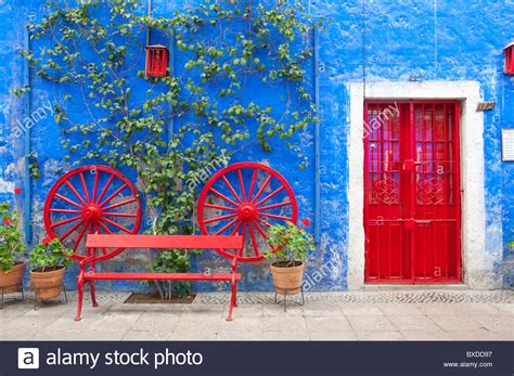 colorful doors colorful courtyard with doors and blue walls in