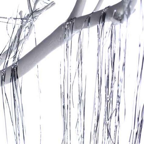 strands of retro inspired silver metallic tinsel strands