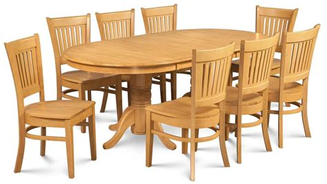 9 pc dining room sets 9 pc oval dining room set in oak finish express home decor