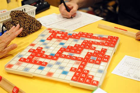 re in scrabble re evaluating the values of the tiles in scrabble the