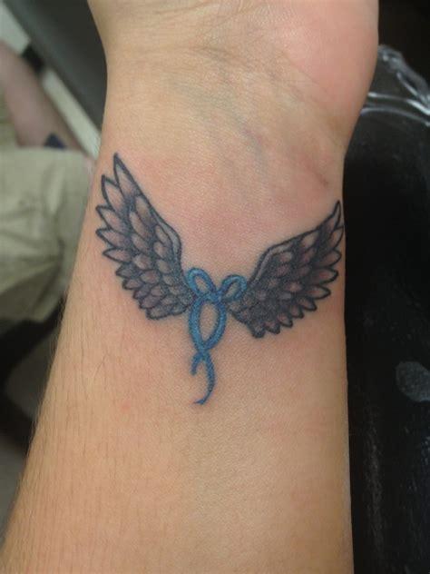 elagant angle 28 wings tattoos on wrists