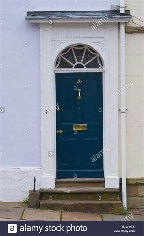 glazed front door and frame blue panelled front door with white frame and semi