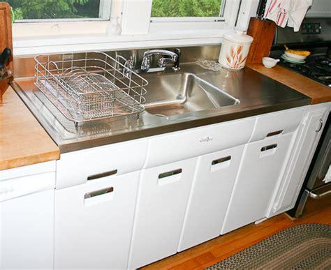 kitchen sinks with drainboard built in besto
