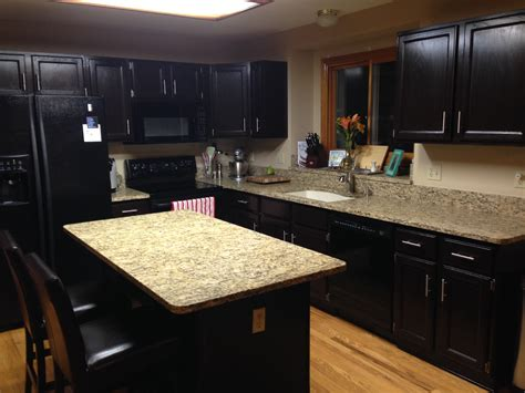 black oak kitchen cabinets staining oak kitchen cabinets with black color and quartz