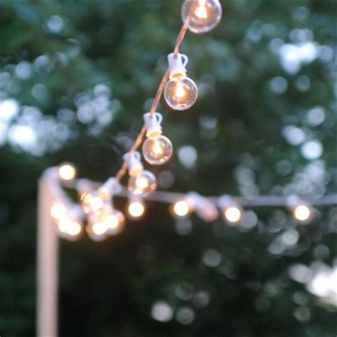 how to hang outdoor patio string lights fall decor idea succulent pumpkins lemonade