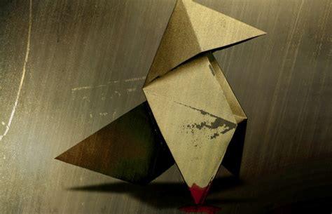 heavy the origami killer heavy dlc to explore the origins of the origami killer