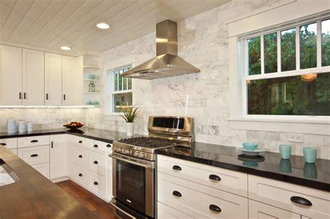 carrara marble kitchen island white kitchen with wood island carrara backsplash black