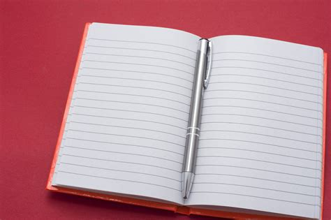 note book picture free stock photo 5411 opened notebook and pen freeimageslive