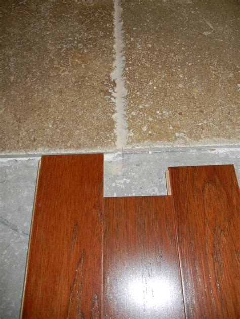 Carpet That Looks Like Wood Planks by Transition Travertine To Engineered Wood Flooring