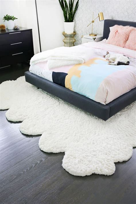 how to make a large area rug try this make two rugs into one large rug a beautiful mess