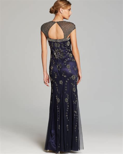 blue beaded gown papell gown cap sleeve flower beaded open back