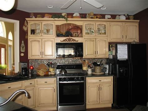 paint colors for kitchen cabinets with black appliances i like the cabinet colors but the black appliances don t