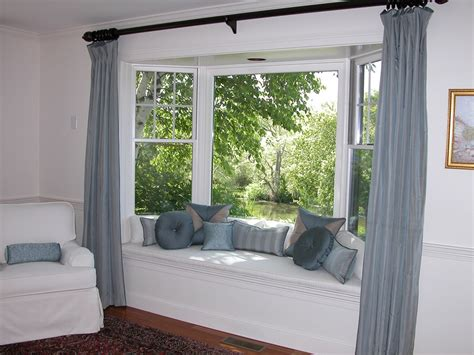 Window Treatment Ideas For Bow Windows bay window seat for comfortable seating area at home