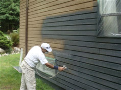 spray painter house cost to paint exterior of house how much to paint a house