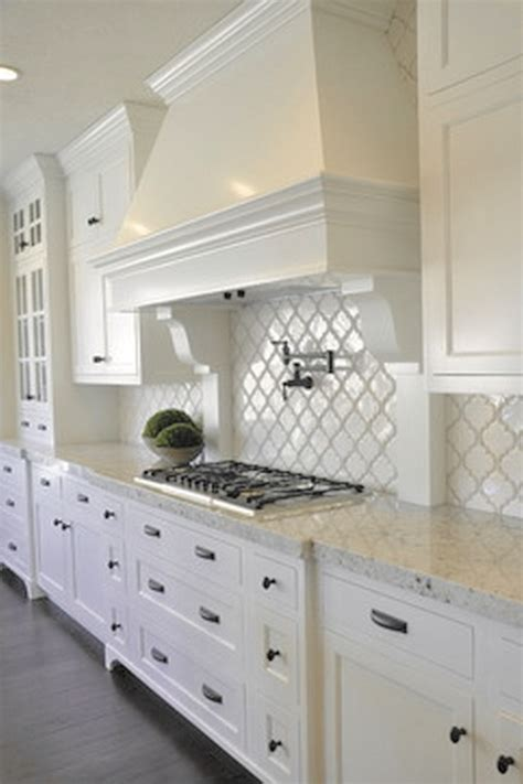 pictures of kitchens with white cabinets and black appliances 25 best ideas about white kitchens on white