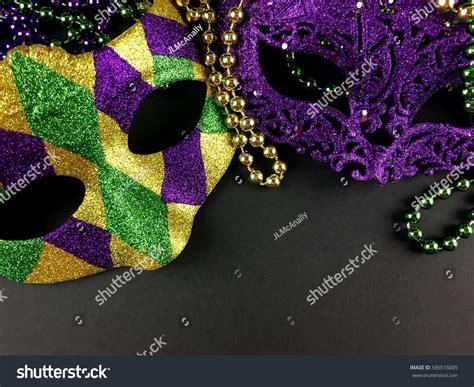 black mardi gras mardi gras masks on black stock photo 586515005
