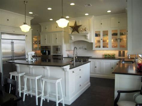 white kitchen island breakfast bar source hgtv floor to ceiling white shaker kitchen cabinets white kitchen island raised