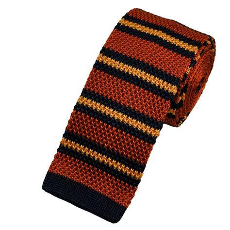 knitted orange tie buck burnt orange golden yellow navy blue striped