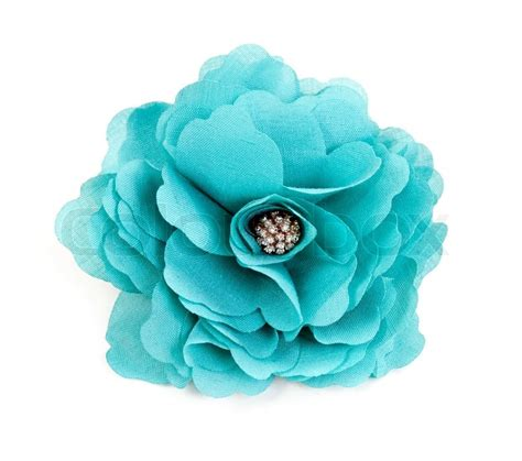 Home Textile Design Jobs turquoise fabric flower isolated on a white background