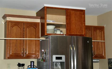 attaching crown moulding kitchen cabinets adding height to the kitchen cabinets tempting thyme