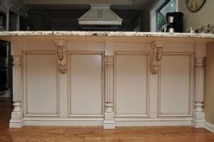kitchen island corbels combining two unlikely designs reeded island posts and acanthus leaf corbels osborne wood