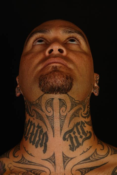 shane tattoos tiki taane throat tattoo
