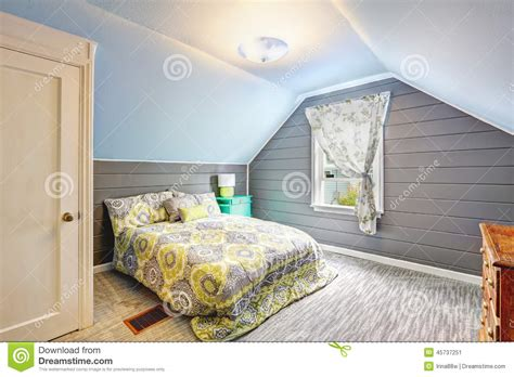 Simple 2 Bedroom House Plans bedroom with vaulted ceiling and plank paneled walls stock
