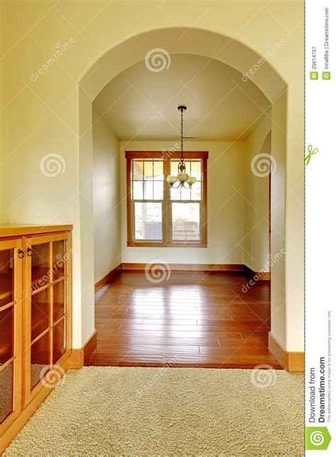 arch with empty room and wood cabinet new luxury home