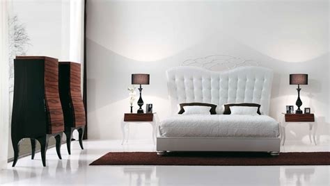 luxury bedroom with beautiful white bed by mobilfresno