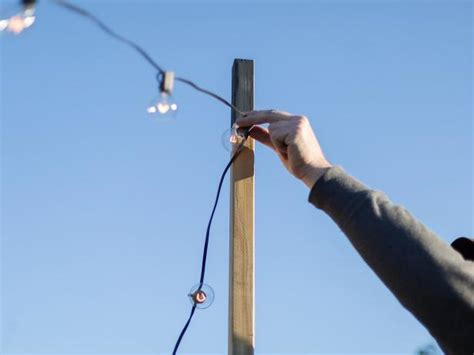 outdoor light string how to hang outdoor string lights from diy posts hgtv