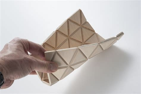 flat origami designs origami inspired flat pack wooden table pops into shape
