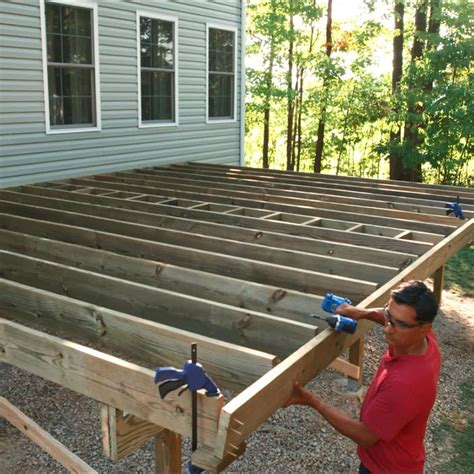 how to frame a floor how to build a deck post holes and framing