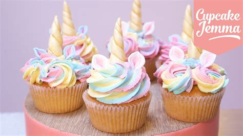 cupcakes and unicorn cupcakes with magic horns and ears cupcake