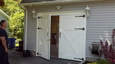 barn door garage door white barn style garage doors combine with gray wall paint